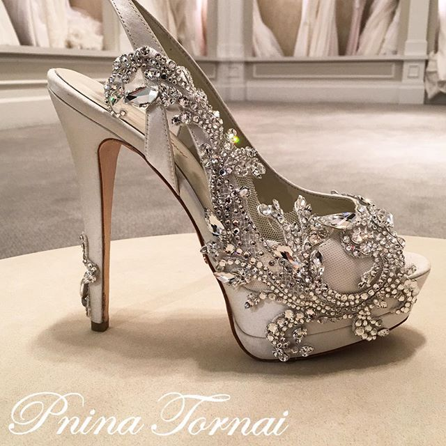 Would you say YES to these custom-made Swarovski crystal illusion embellished #PninaTornaiShoeLine heels?  Our shoe collection is available at @kleinfeldbridal. #TheQueenOfBling