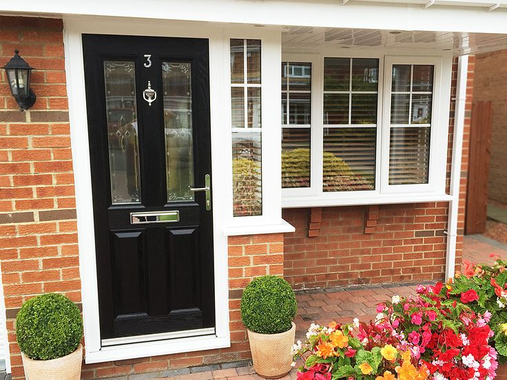 Stunning full house of Windows and doors, with gorgeous Half georgian bar half glass windows, side openers and high quality Rehau UPVC Profile. The door is the ever popular Black Altmore Composite, with a elegant Centaurus glass design within the panels, finished off with Chrome Furniture.