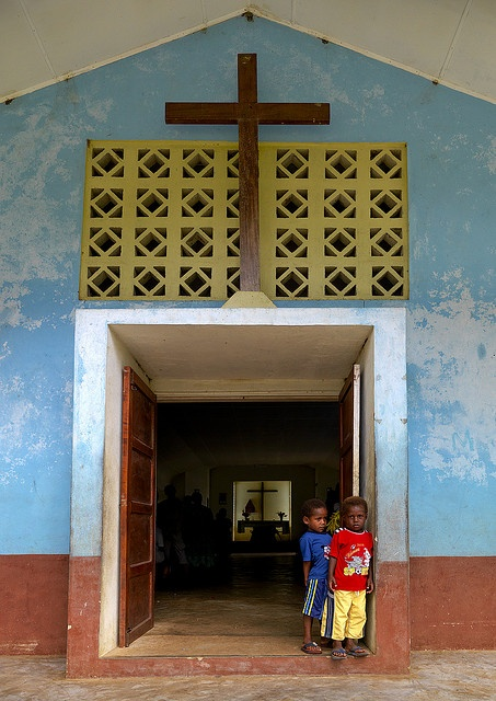 Boys at the entrance of a church in Vanuatu.