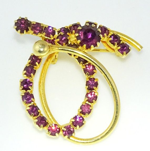 Gorgeous brooch pin with dark purple stones. #adoredblessings