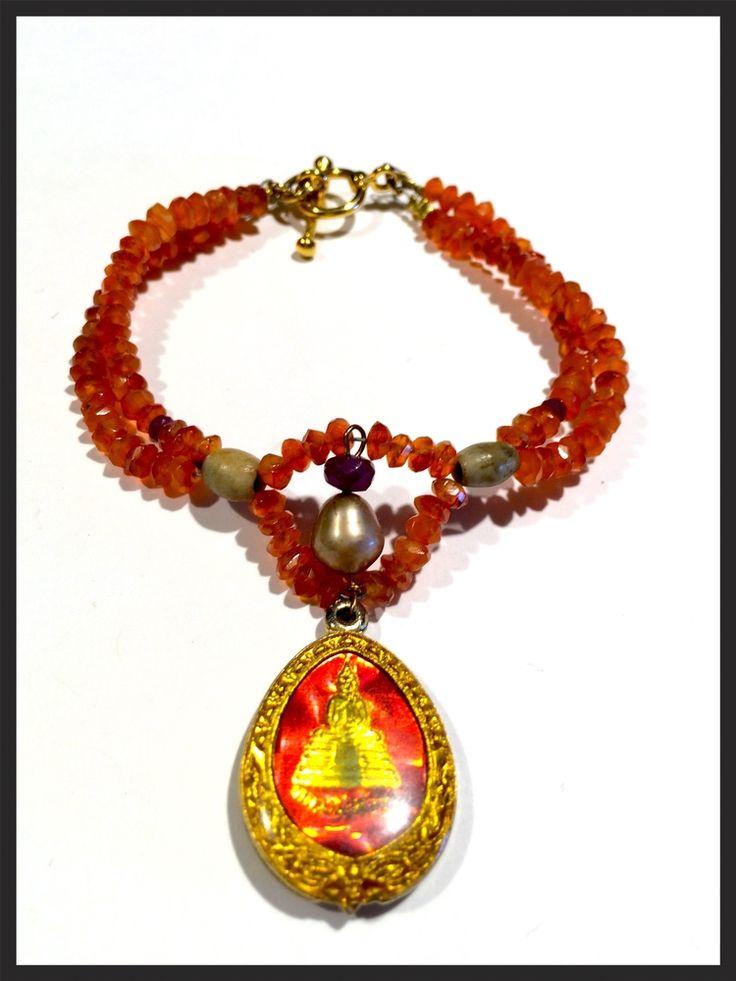 Tibetan Orange Beads and Buddha Charm Bracelet