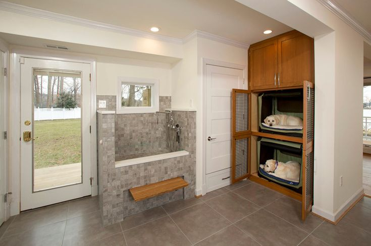 This is so cool.  A pet shower and beds for dogs in the laundry room.  Transitional Laundry Room by Four Brothers LLC