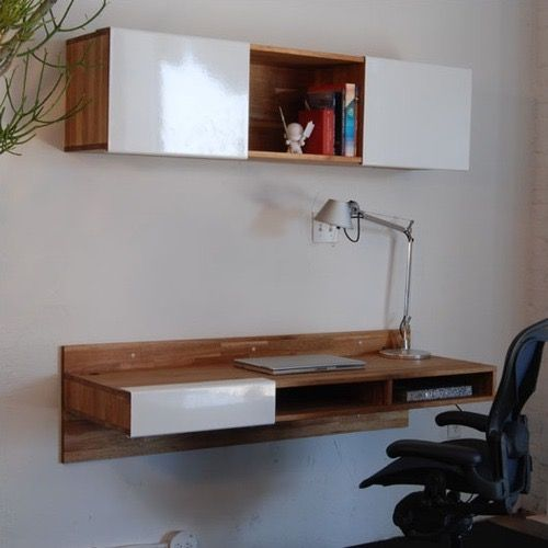 My husband and I have been looking for an unobtrusive desk to create a dedicated workspace for him in our small sitting room