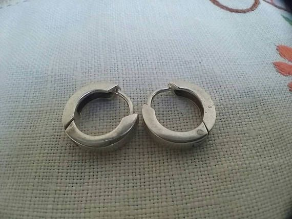 Check out this item in my Etsy shop https://www.etsy.com/au/listing/531828463/vintage-sterling-silver-hoop-earrings