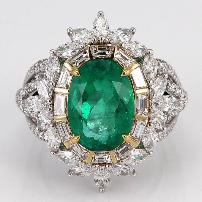 True green with a touch of sparkle. Emerald ring with diamonds by Kat Florence