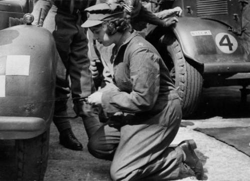 Princess Elizabeth (future Queen Elizabeth II) changing the wheel of an ambulance. Elizabeth joined the Women's Auxiliary Territorial Service (WATS) in February 1945, and was trained as an ambulance driver.