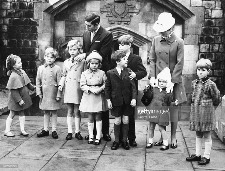Prince Charles (behind, left), Prince Andrew and Princess Anne (behind, right) arranging a group of Royal grandchildren for a portrait (L-R) Lady Sarah Armstrong-Jones, James Ogilvy, the Earl of St Andrews, Lady Helen Windsor, Viscount Linley, Marina Ogilvy and Prince Edward (far right), at Windsor Castle, England, Devember 27th 1969.