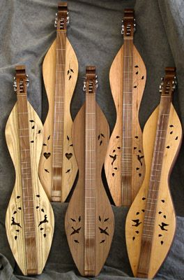 A few hourglass shape mountain dulcimers. Craggy Mountain's Walnut Creek Dulcimers.