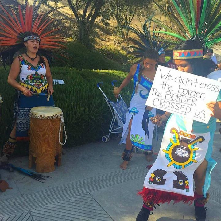 We Didn't Cross the Border, the Border Crossed Us! Aztec dancers evoke the ancestors at anti-Donald Trump/Republican Party protests during yesterday's GOP Debate in Simi Valley, California. Credit: Veronica Valadez of Danza Mexica Cuauhtemoc