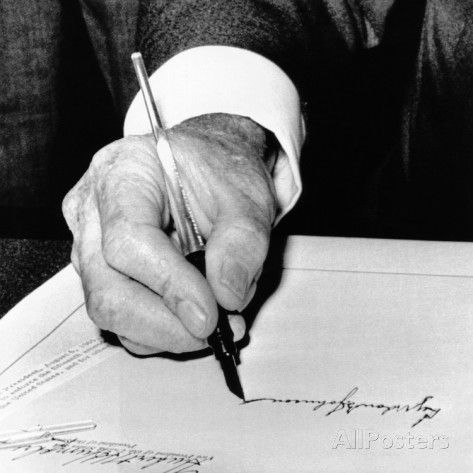 President Lyndon Johnson Signing the 1965 Civil Rights Bill, also known as the Voting Rights Act Photographic Print at AllPosters.com