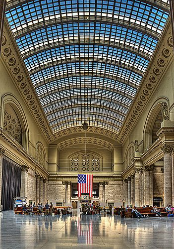 Union Station, Chicago, Illinois. Two statues on the east wall hold a rooster and an owl, signifying day/night, the 24 hour nature of railroad travelers
