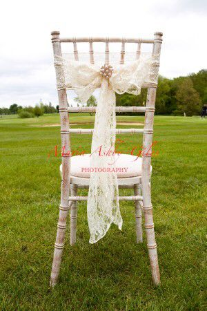 Vintage Ivory lace with vi rage pearl diamanté buckle chair sash by Fuschia on shabby chic style chair. The perfect touch for a vintage / rustic style wedding.