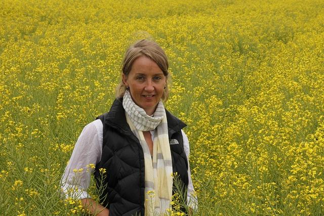 Bayer's Nina McCormick stands amongst the canola blooms | www.bayergoldenage.com