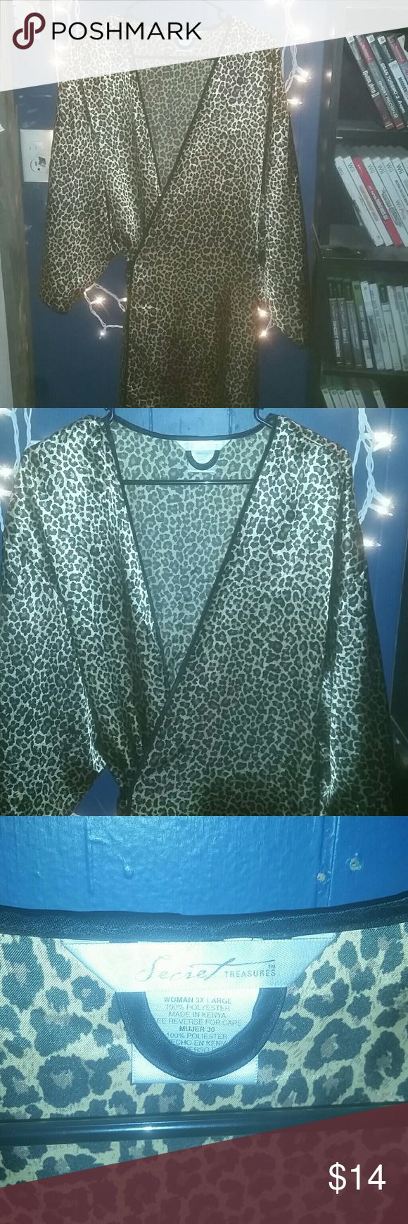 Cheetah print robe I used this mainly to cut hair when I was in hair school. My ladies loved it.   Size is a 3XL fits a large also  It's really used for you to walk around the house in, or when you go to bed    Never worn or used by me, only for hair.   In very good condition, very very clean.  No signs of wear or tear.   Same day shipping if bought before 5! secret treasures  Intimates & Sleepwear Chemises & Slips