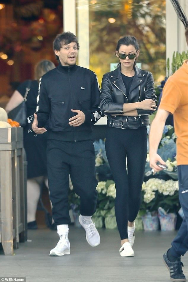 Caution! Do not enter! Louis Tomlinson was pictured shopping with forlorn girlfriend Elean...