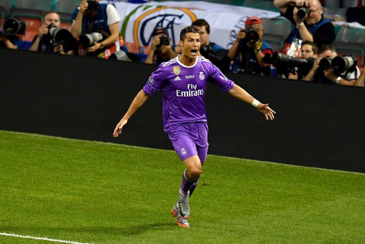 Cristiano Ronaldo Photos Photos - In this handout image provided by UEFA, Cristiano Ronaldo of Real Madrid celebrates scoring his sides third goal during the UEFA Champions League Final between Juventus and Real Madrid at National Stadium of Wales on June 3, 2017 in Cardiff, Wales. - Juventus v Real Madrid - UEFA Champions League Final