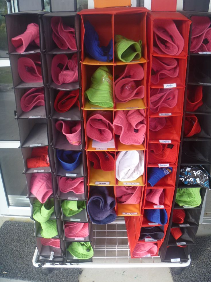 Hat storage pockets early childhood ideas for work for Hat hanging ideas
