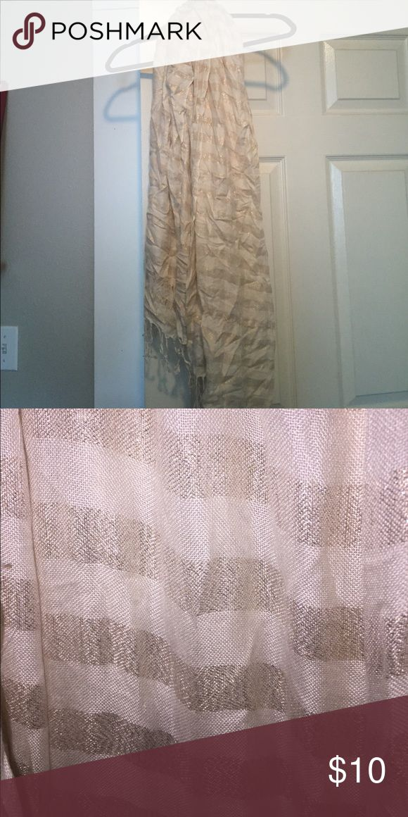 Beautiful cream and gold scarf White cream scarf that is striped with gold thread. The bottom of the scarf is frayed and is perfect for those fall days that are around the corner. I would love to bundle these with the other scarves listed if interested Free People Accessories Scarves & Wraps