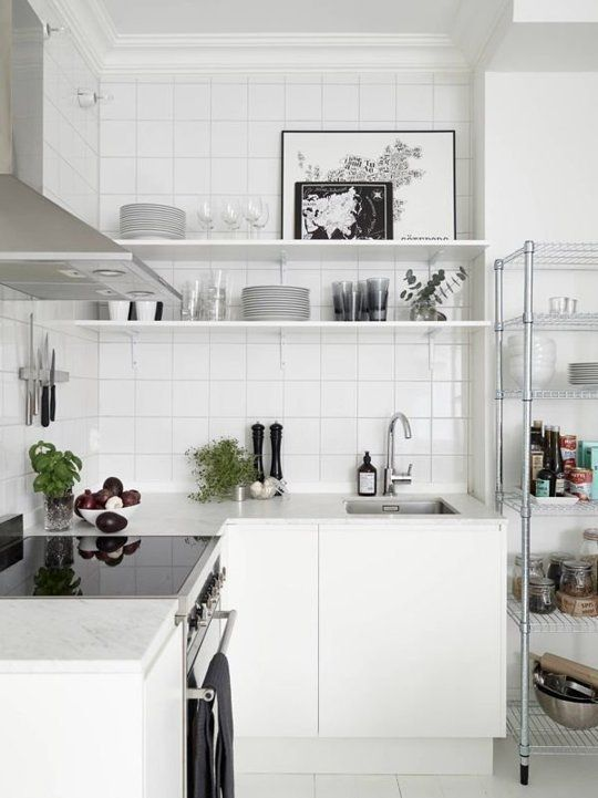 Make Your Small Apartment Kitchen a Little Bit Bigger - Another way to do this is with rolling industrial shelving. It can look especially nice in a minimal, modern kitchen, as seen on The Style Files.