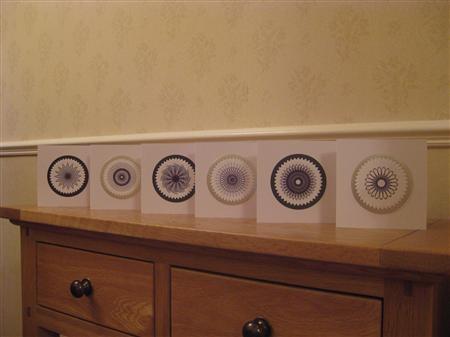 Spirograph art cards. [ From: http://www.craftsforum.co.uk/showthread.php?40413-Spirograph-Art-Cards ]