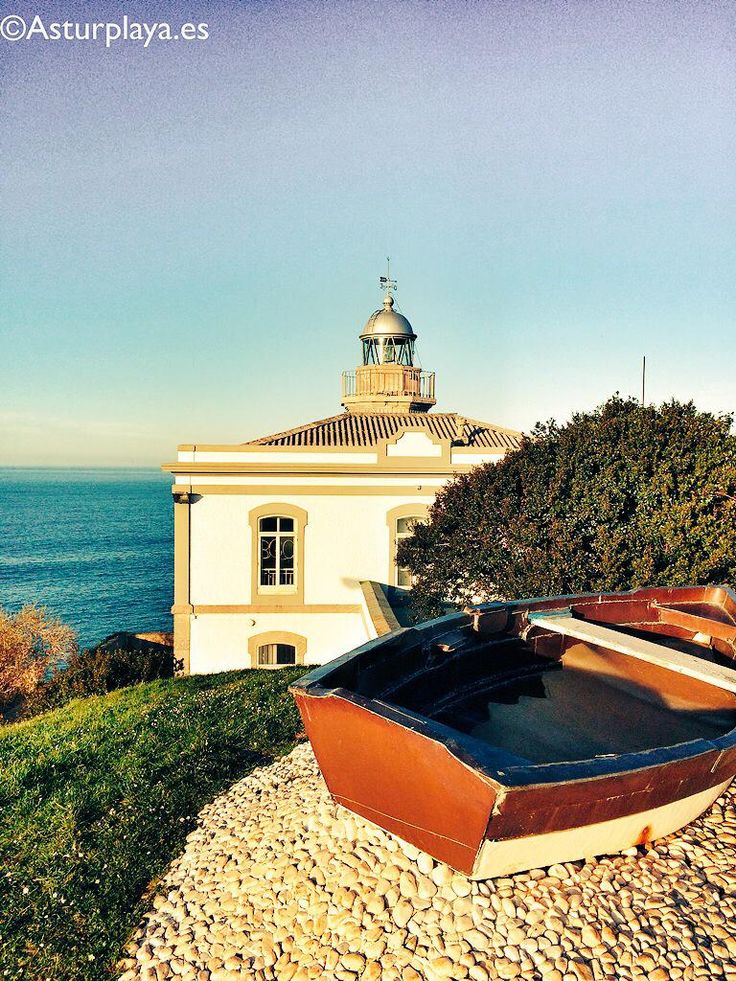 Candás lighthouse on a sunny spring day. Go on, step into the boat! #Asturias #Spain
