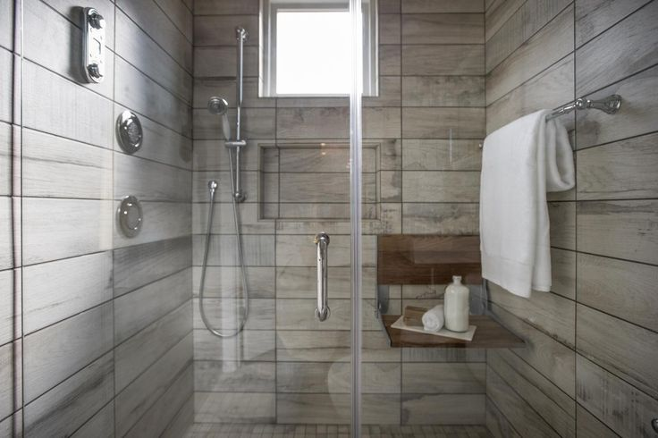 Large and spacious, the porcelain tile shower is equipped
