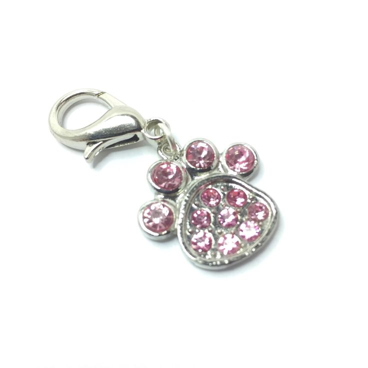Pink Diamante Pawprint Pet Collar Tag, Pet Collar Jewellery, Rhinestone Paw Print for Dog Collar, Cat Collar Jewellery, Add Initial https://www.etsy.com/listing/576840657/pink-diamante-pawprint-pet-collar-tag?utm_campaign=crowdfire&utm_content=crowdfire&utm_medium=social&utm_source=pinterest