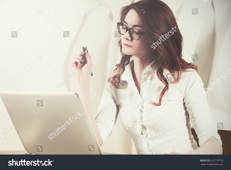 Woman is working at the computer in the office