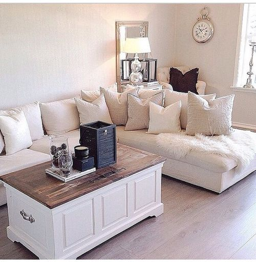 This is my kind of living space. Neutral, light and airy. The best part about whites and creams like these is that it feels cool and fresh in the summer and nice and cozy in the winter.