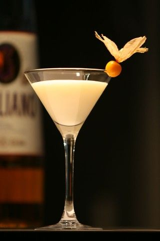The Golden Cadillaс Cocktail garnished with ground-cherry