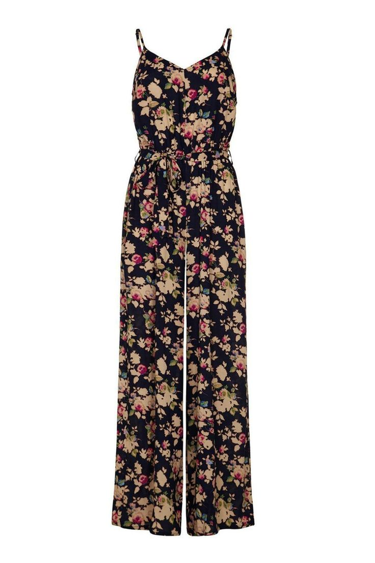Yumi Floral Print Jumpsuit. In a vintage inspired floral print, this jumpsuit is '70s trend must have for the new season. With wide legs, it features a V-neckline, adjustable spaghetti straps, a slim waist tie and gold button fastening at the back. Team with platform heels and tousled hair for a retro look.   Floral Print Jumpsuit by Yumi. Clothing - Jumpsuits & Rompers - Jumpsuits Canada