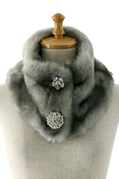 faux fur neck warmer with brooches. This grey should go well with navy, balck, and white coats. Or, even with beige ones.