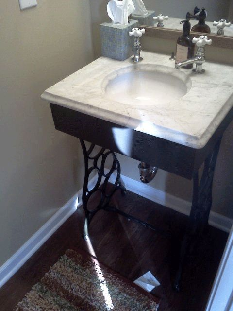Turn an antique sewing table into a beautiful sink.