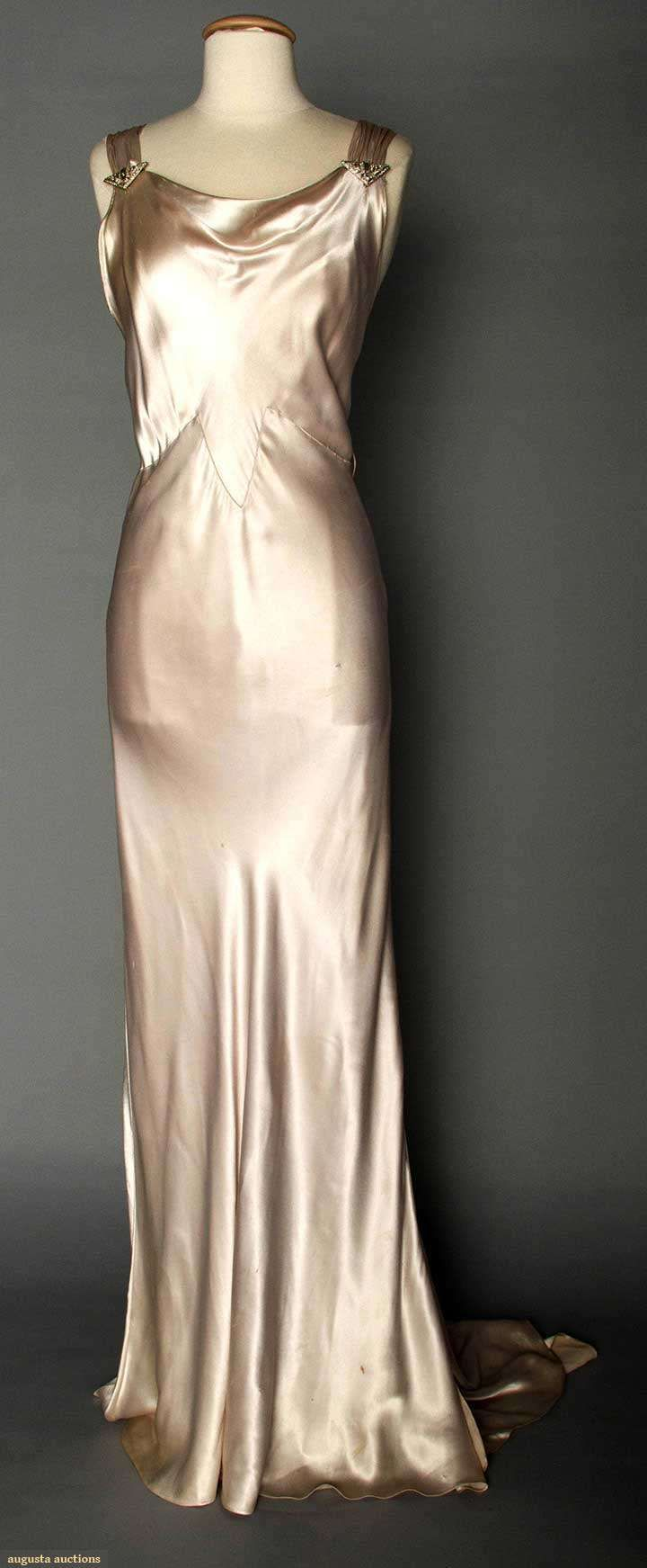 "~SILVER SATIN EVENING GOWN, 1930s~ Pale lavender/silver silk charmeuse, bias-cut, sleeveless, cowl neckline, open back, jeweled Deco elements on shoulder straps & at CB, floating trained back panel, labeled ""NRA Code, Made Under Dress Code Authority PHB038577"", B 34""-36"", H 35""-38"", L 62""-72"", (belt missing)"