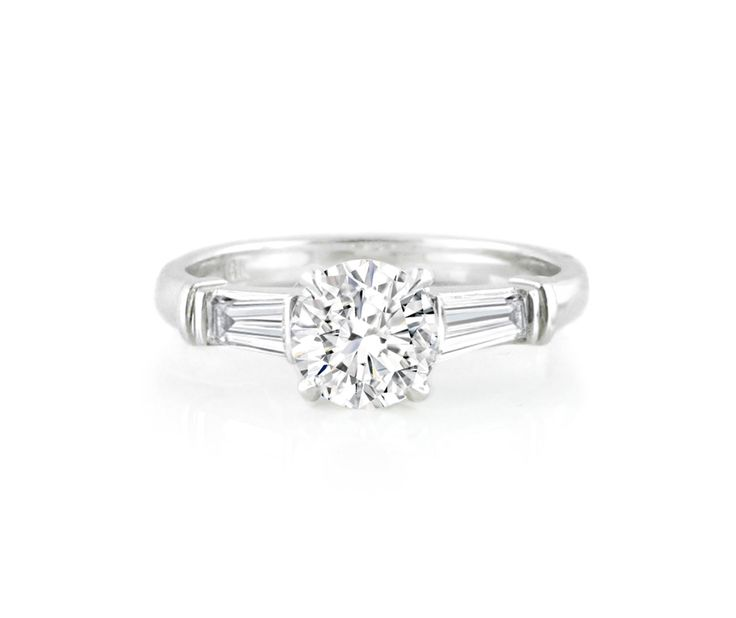 An 18ct White Gold and Diamond Trilogy Ring