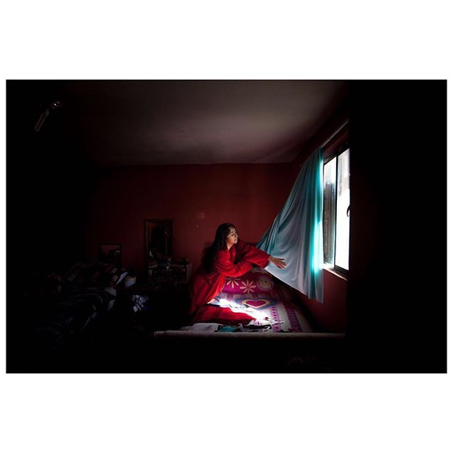 Briza, now 14, in her home. She was just 7 when her mother was arrested in their home in Arizona. Separated by the border, Briza chose to move to Nogales to be with her mother, Gloria. She is the only child from the family who made that choice. It took the two about a year to get to know each other again. Nogales, Mexico. April, 2017 . © @markosian/#MagnumPhotos . From a year of Magnum Photos in review, edited by President Thomas Dworzak.  #DianaMarkosian #Mexico