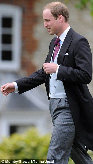 Prince William, was believed to have been an usher, wearing the same morning suit, blue striped shirt, and dark red tie.
