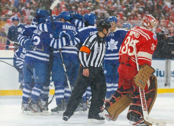 Detroit Red Wings goalie Jimmy Howard (35) skates by as the Toronto Maple Leafs celebrate their 3-2 win in a shootout. (Paul Sancya/AP)