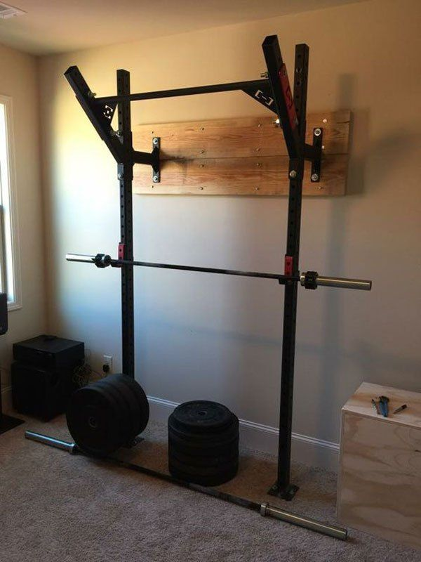Bedroom gym equipped with HI-Temps and the Slim Gym wall rack