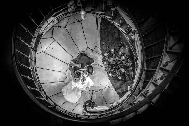 Bride and Groom at the Cotswold House Hotel, amazing spiral staircase and creative lighting give this shot drama!