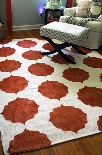 DIY painted area rug using clear contact paper as a stencil