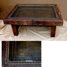 Leather trimmed coffee table with display cases, perfect for belt buckles.