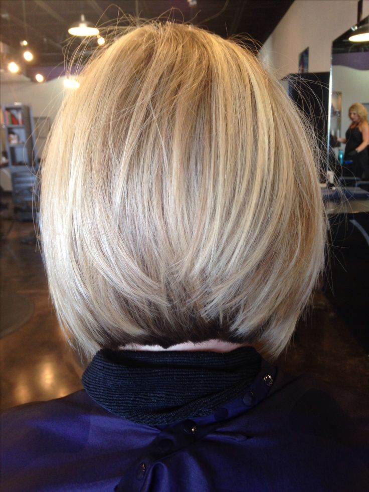 Blond inverted stacked bob                                                                                                                                                                                 More