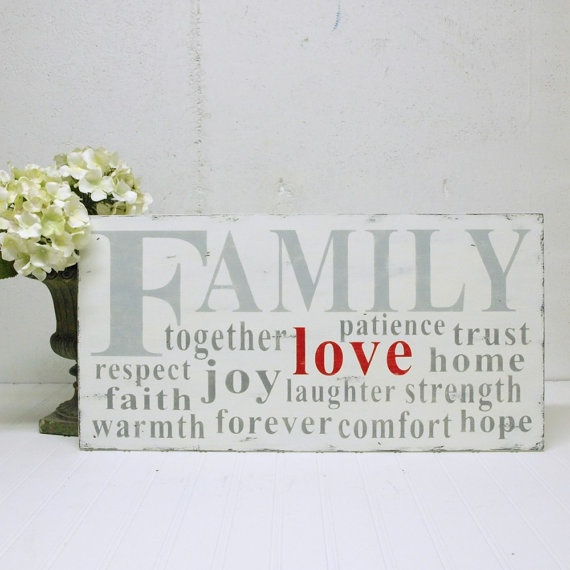 Gorgeous sign... LOVE is at the centre of family! Love it!