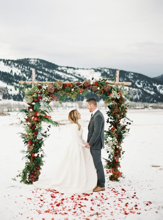 Gorgeous wintery wedding ceremony: http://www.stylemepretty.com/2015/12/25/happy-holidays-elegant-winter-wedding-inspiration/ | Photography: Rebecca Hollis - http://rebeccahollis.com/