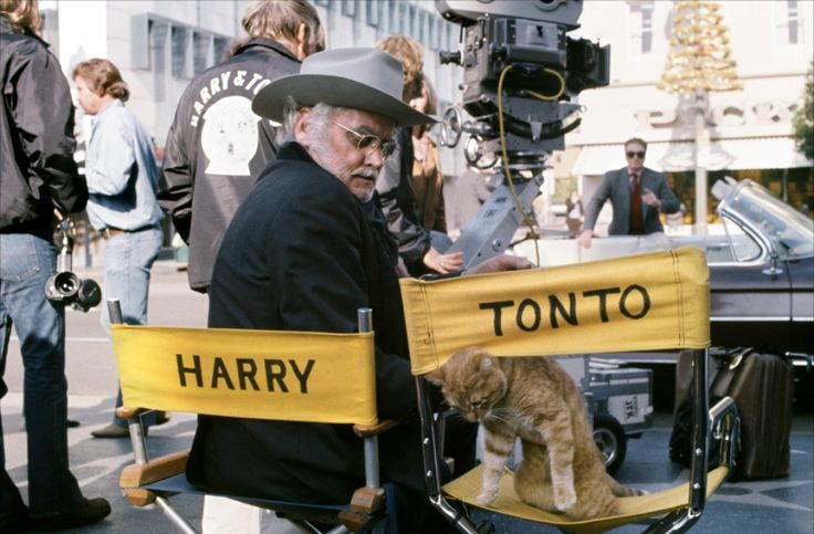 """Art Carney and one of two cats playing Tonto in the 1974 road film """"Harry and Tonto"""" by Paul Mazursky."""