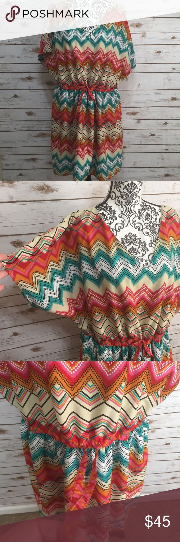 Lane Bryant multi colored chevron Dress Size 22/24 multi colored v neck chevron print dress from Lane Bryant. Dress is fully lined. Elastic drawstring waist. Offers are welcome but I don't trade. Lane Bryant Dresses Mini