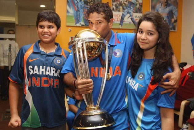 Sachin Tendulkar (C) of India alongside his son Arjun (L) and daughter Sara (R) during the 2011 ICC World Cup Final between India and Sri Lanka at Wankhede Stadium on April 2, 2011 in Mumbai, India.