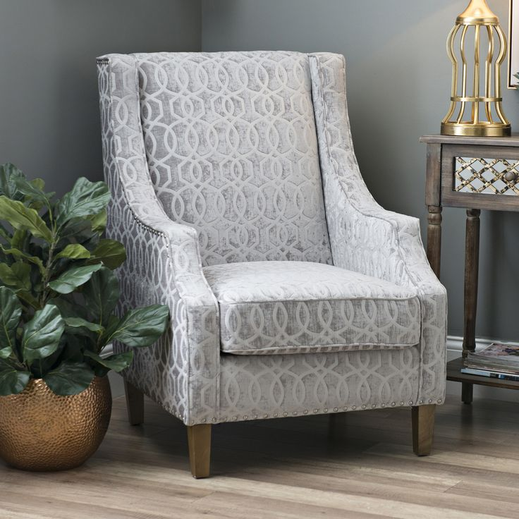 the quinn dove gray accent chair is a simple yet elegant seating choice for any decor