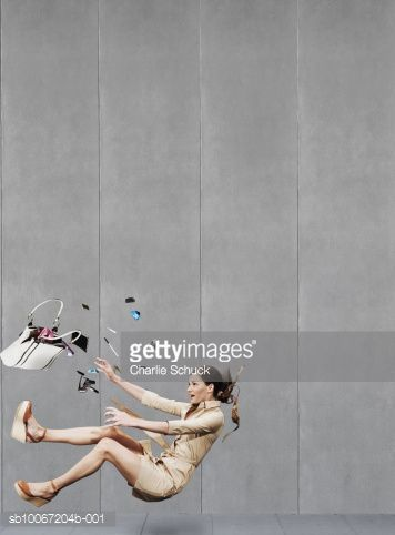 Stock Photo : Woman falling down on pavement